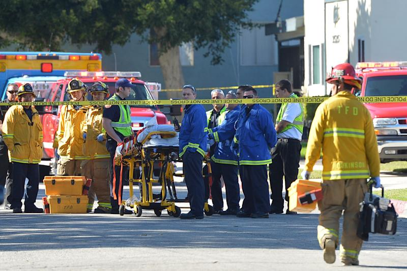 Torrance police and fire respond to a call at Golden West Tower on Maricopa Street in Torrance, Calif., Tuesday afternoon, Nov. 20, 2012. Three people died Tuesday in what appeared to be a double murder-suicide at the senior citizens' high-rise south of Los Angeles, police said. (AP Photo/The Daily Breeze, Robert Casillas) MAGS OUT; NO SALES
