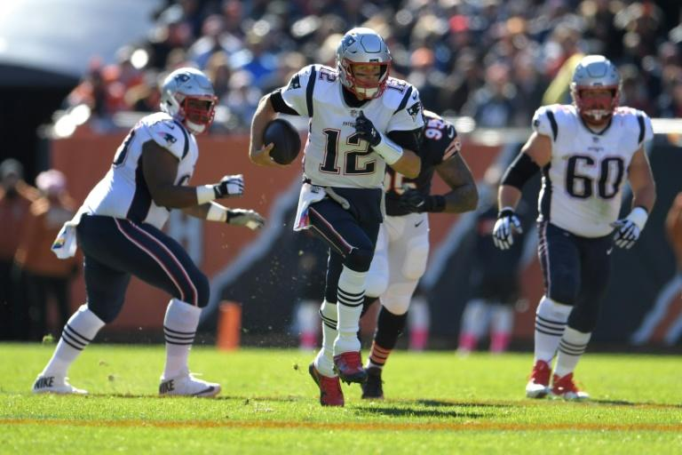 Tom Brady threw for 277 yards and three touchdowns as the New England Patriots earned their first road win of the season by rallying to defeat the Chicago Bears 38-31