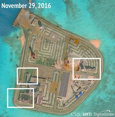 A satellite image shows what CSIS Asia Maritime Transparency Initiative says appears to be anti-aircraft guns and what are likely to be close-in weapons systems (CIWS) on the artificial island Johnson Reef in the South China Sea in this image released on December 13, 2016. Courtesy CSIS Asia Maritime Transparency Initiative/DigitalGlobe/Handout via REUTERS