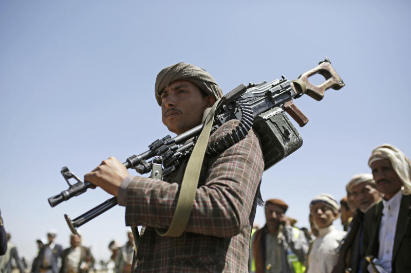 A Shiite Houthi tribesman holds his weapon during a tribal gathering showing support for the Houthi movement, in Sanaa, Yemen, Saturday Sept. 21, 2019. Yemen's Houthi rebels said late Friday night that they were halting drone and missile attacks against Saudi Arabia, one week after they claimed responsibility for a strike that crippled a key oil facility in the kingdom. (AP Photo/Hani Mohammed)