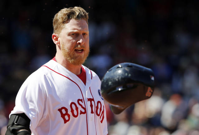 Boston Red Sox's Mike Carp watches his helmet after he threw it when he grounded out to end the ninth inning with two runners on base during their 7-6 loss to the Baltimore Orioles in a baseball game at Fenway Park in Boston Monday, April 21, 2014. (AP Photo/Winslow Townson)