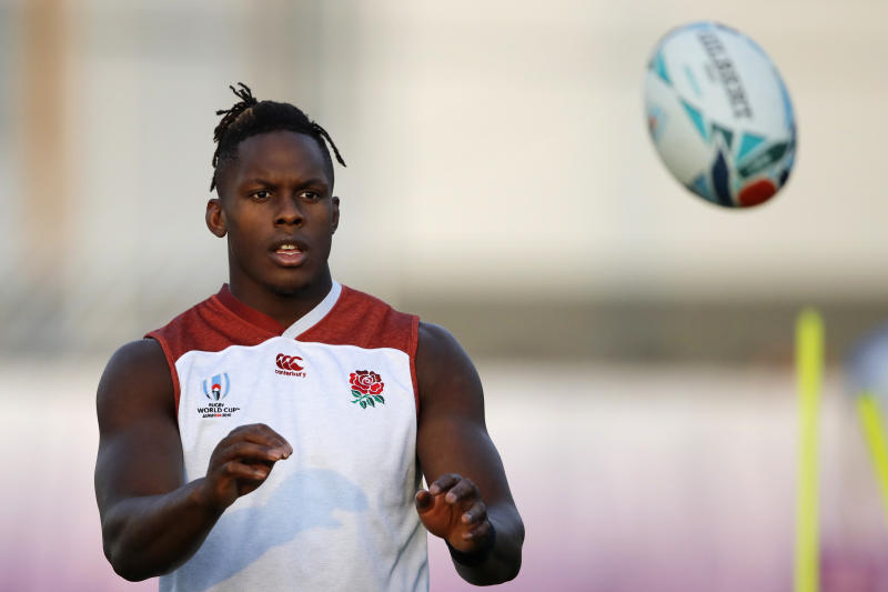 FILE - In this Wednesday, Oct. 23, 2019 file photo, England's Maro Itoje catches the ball during a training session in Urayasu, Japan. There are more questions than answers in a massive rugby scandal that on Saturday, Jan. 18, 2020 saw English and European champion Saracens get relegated for breaching salary-cap regulations. They own some of the most high-profile players in the sport, like England captain Owen Farrell and World Player of the Year nominees Maro Itoje and Billy Vunipola (AP Photo/Christophe Ena, file)