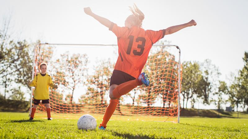 girl playing soccer for extracurricular activities