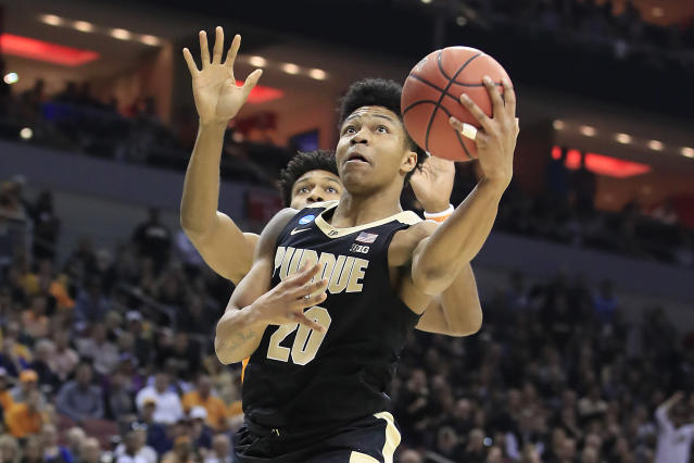 <p>Nojel Eastern #20 of the Purdue Boilermakers goes up for a layup against the Tennessee Volunteers during the first half of the 2019 NCAA Men's Basketball Tournament South Regional at the KFC YUM! Center on March 28, 2019 in Louisville, Kentucky. (Photo by Andy Lyons/Getty Images) </p>