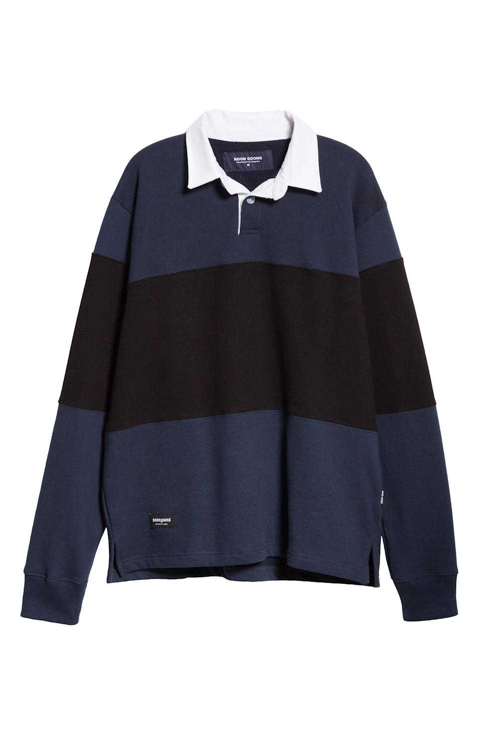 """<p><strong>NOON GOONS</strong></p><p>nordstrom.com</p><p><strong>$249.00</strong></p><p><a href=""""https://go.redirectingat.com?id=74968X1596630&url=https%3A%2F%2Fwww.nordstrom.com%2Fs%2Fnoon-goons-tri-long-sleeve-mens-rugby-polo%2F5664397&sref=https%3A%2F%2Fwww.esquire.com%2Fstyle%2Fmens-fashion%2Fg28074063%2Fbest-rugby-shirts%2F"""" rel=""""nofollow noopener"""" target=""""_blank"""" data-ylk=""""slk:Shop Now"""" class=""""link rapid-noclick-resp"""">Shop Now</a></p>"""