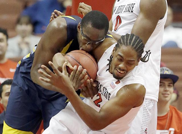 Marquette center Chris Otule, right, and San Diego State forward Josh Davis grapple in the first half of an NCAA college basketball game at the Wooden Legacy tournament in Anaheim, Calif., Sunday, Dec. 1, 2013. (AP Photo/Reed Saxon)