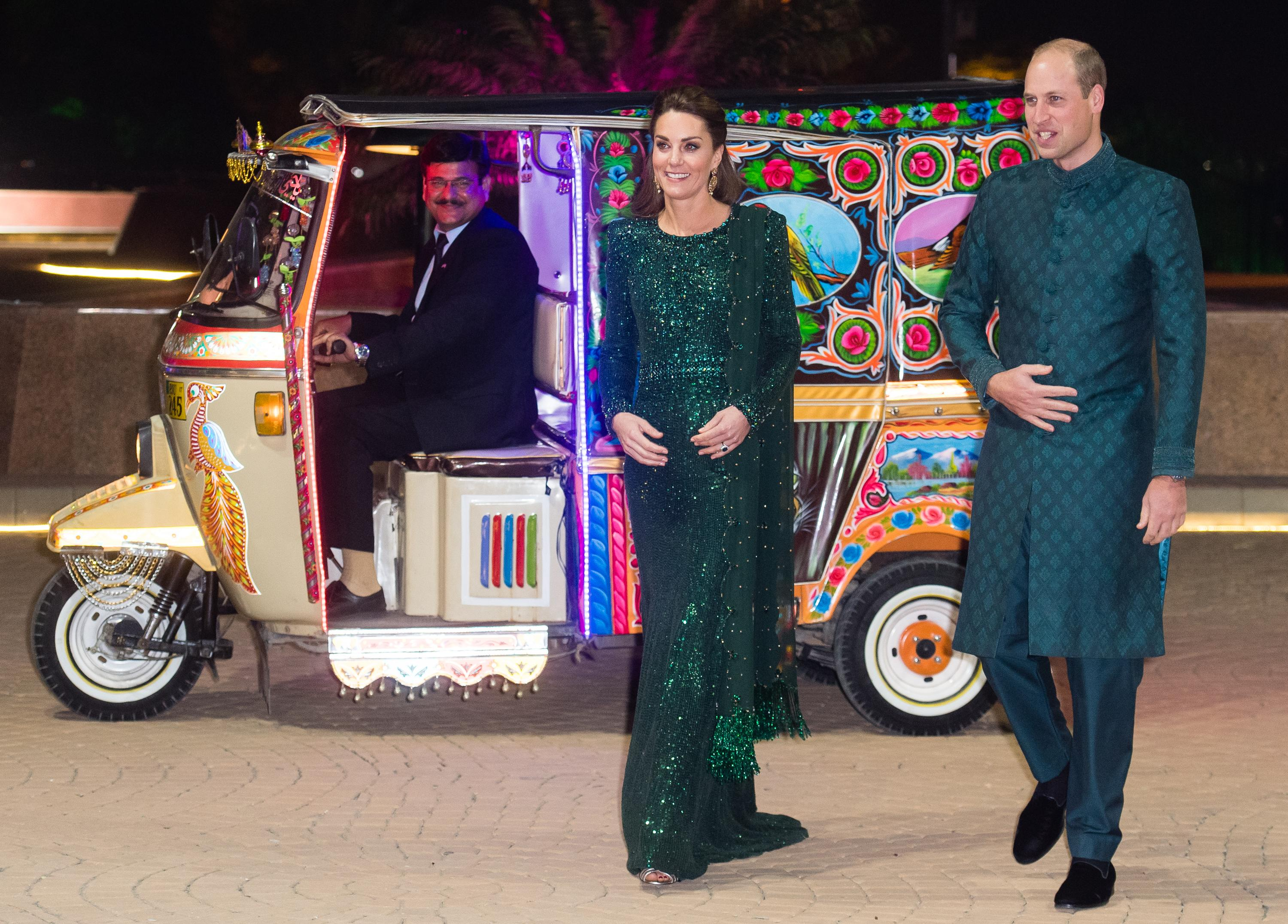 Duchess of Cambridge and Prince William, Duke of Cambridge arrive by Tuk Tuk as they attend a special reception hosted by the British High Commissioner Thomas Drew. [Photo: Getty]