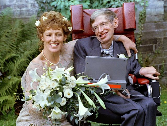 <p>Stephen Hawking and his new bride Elaine Mason pose for pictures after the blessing of their wedding at St. Barnabus Church, Sept. 16, 1995. The two honeymooned in Scotland. (Photo: Russell Boyce/Reuters) </p>