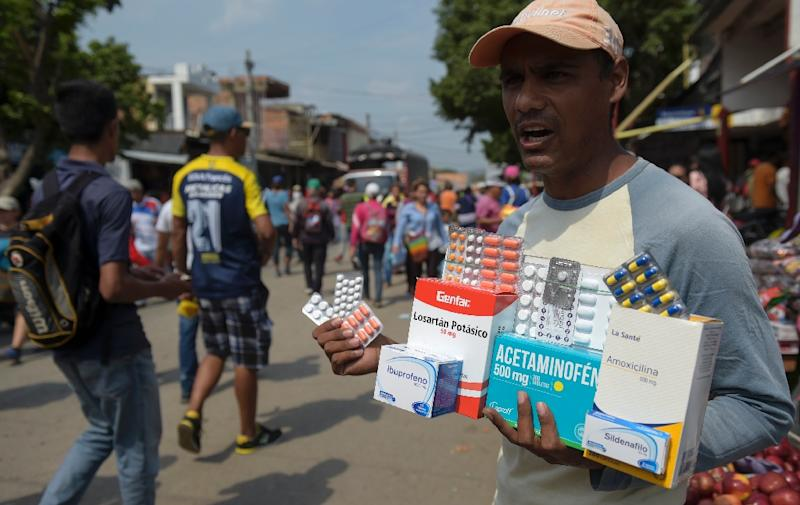 On a street in the Colombian town of Cucuta, a man sells drugs in a business largely patronized by people from nearby Venezuela, which is facing grave drug shortages amid its economic and political crisis (AFP Photo/Raul ARBOLEDA)