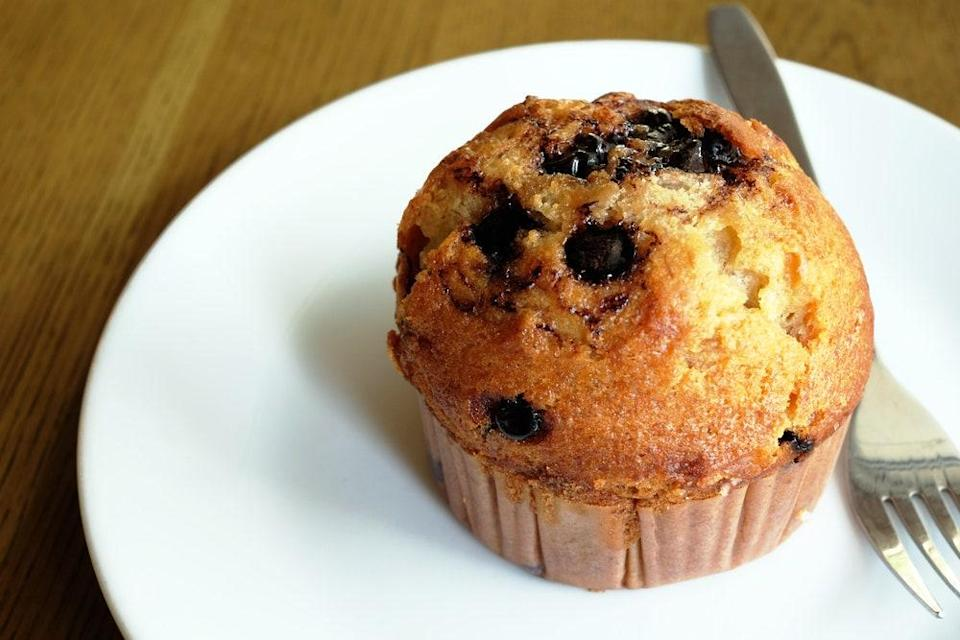 """This muffin recipe is full of chocolate and banana flavor. Mix your dry ingredients together before adding a cup of mashed bananas followed by chocolate chips. <a href=""""https://www.epicurious.com/recipes/food/views/banana-chocolate-chip-muffins-101020?mbid=synd_yahoo_rss"""" rel=""""nofollow noopener"""" target=""""_blank"""" data-ylk=""""slk:See recipe."""" class=""""link rapid-noclick-resp"""">See recipe.</a>"""