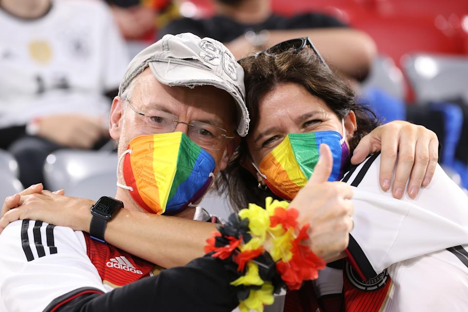 MUNICH, GERMANY - JUNE 23: Fans of Germany wearing rainbow masks gesture prior to the UEFA Euro 2020 Championship Group F match between Germany and Hungary at Allianz Arena on June 23, 2021 in Munich, Germany. (Photo by Alexander Hassenstein/Getty Images)