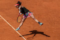 Japan's Misaki Doi serves to Japan's Naomi Osaka during their match at the Mutua Madrid Open tennis tournament in Madrid, Spain, Friday, April 30, 2021. (AP Photo/Bernat Armangue)