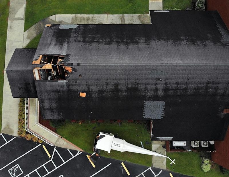 A steeple lies next to the Elah Baptist Church after being blown off by the strong winds of Hurricane Florence in Leland, North Carolina.