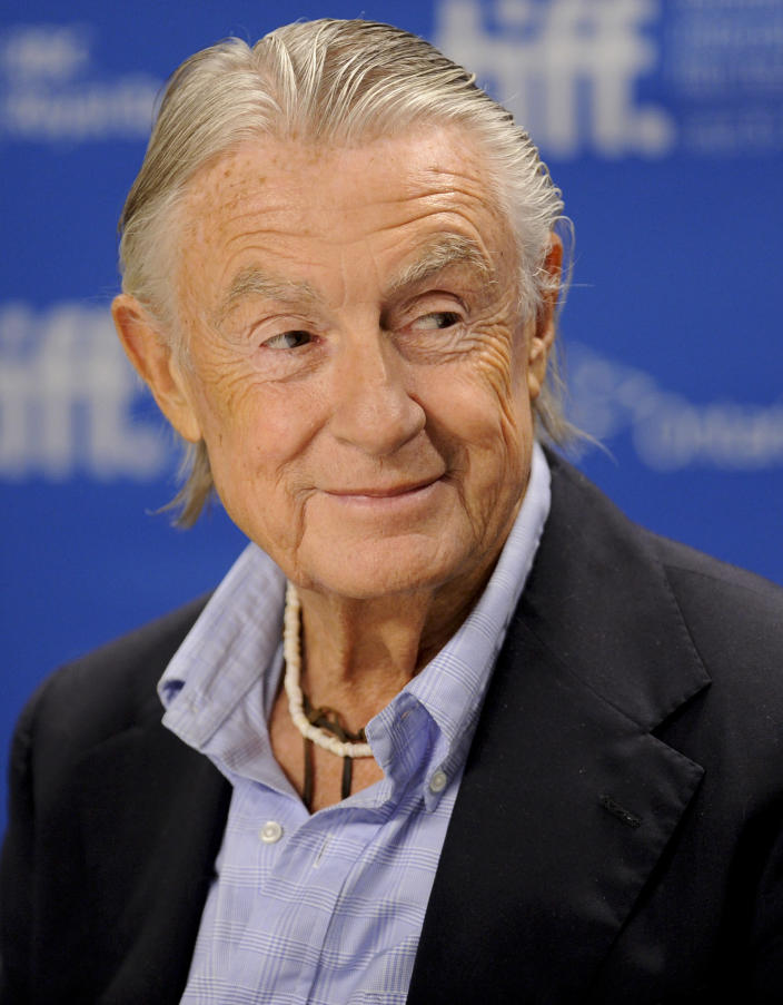 """FILE - In this Sept. 14, 2011 file photo, director Joel Schumacher participates in a news conference for the film """"Trespass"""" during the Toronto International Film Festival. A representative for Schumacher said the filmmaker died Monday, June 22, 2020, in New York after a year-long battle with cancer. He was 80. (AP Photo/Evan Agostini, File)"""