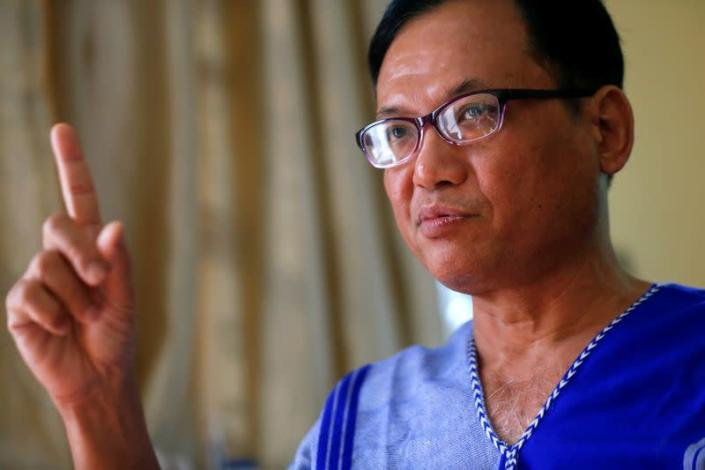 Padoh Saw Taw Nee, Head of Foreign Affairs Department of the Karen National Union talks during an interview with Reuters journalist in Mae Sot