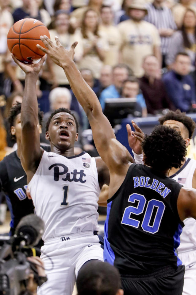 Pittsburgh's Xavier Johnson (1) shoots over Duke's Marques Bolden (20) during the first half of an NCAA college basketball game, Tuesday, Jan. 22, 2019, in Pittsburgh. (AP Photo/Keith Srakocic)