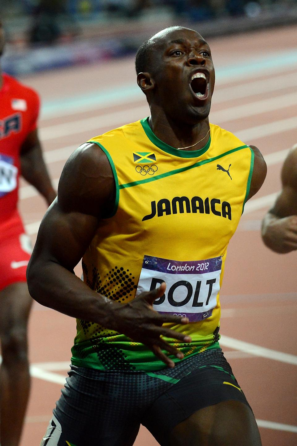 Usain Bolt of Jamaica celebrates after crossing the finish line to win the gold medal in the Men's 100m Final on Day 9 of the London 2012 Olympic Games at the Olympic Stadium on August 5, 2012 in London, England. (Photo by Shaun Botterill/Getty Images)
