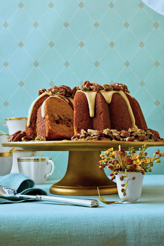 """<p><strong>Recipe:</strong> <a href=""""http://www.myrecipes.com/recipe/cranberry-apple-pumpkin-bundt-50400000124723/"""" target=""""_blank""""><strong>Cranberry-Apple-Pumpkin Bundt</strong></a></p> <p>The topping on this bundt—a maple glaze with sugared pecans and pumpkin seeds—will make your guests ooh and ahh.</p>"""