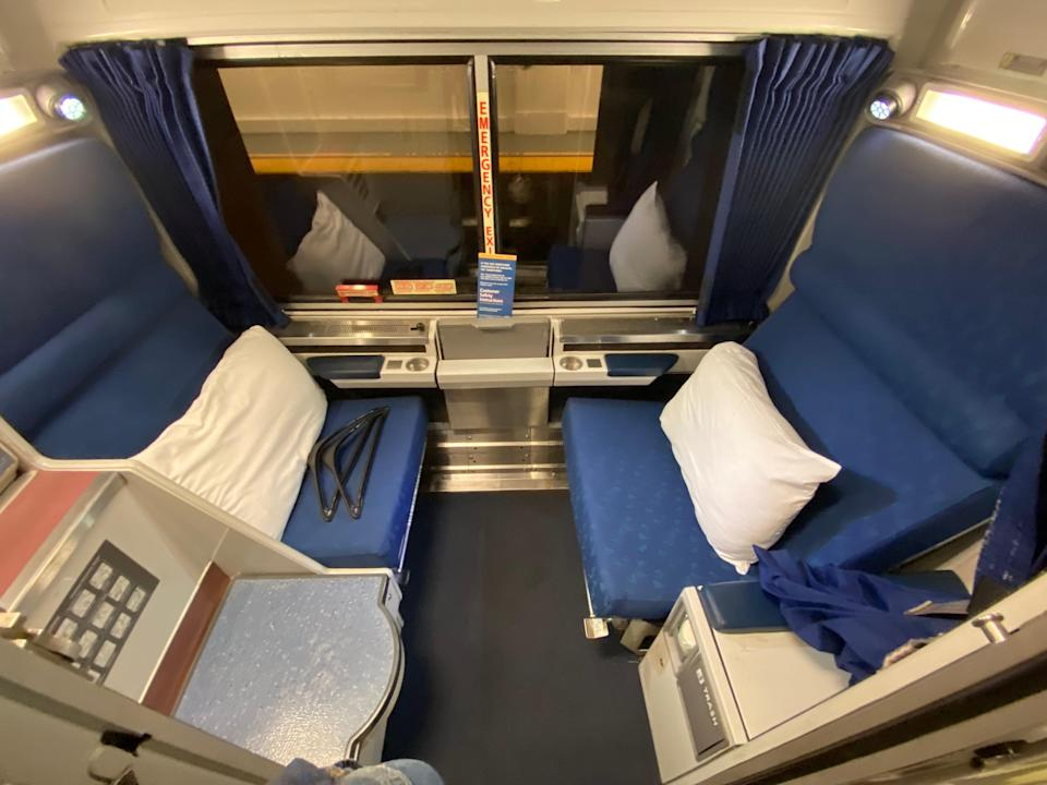 A room aboard the amtrak train with two seats facing each other