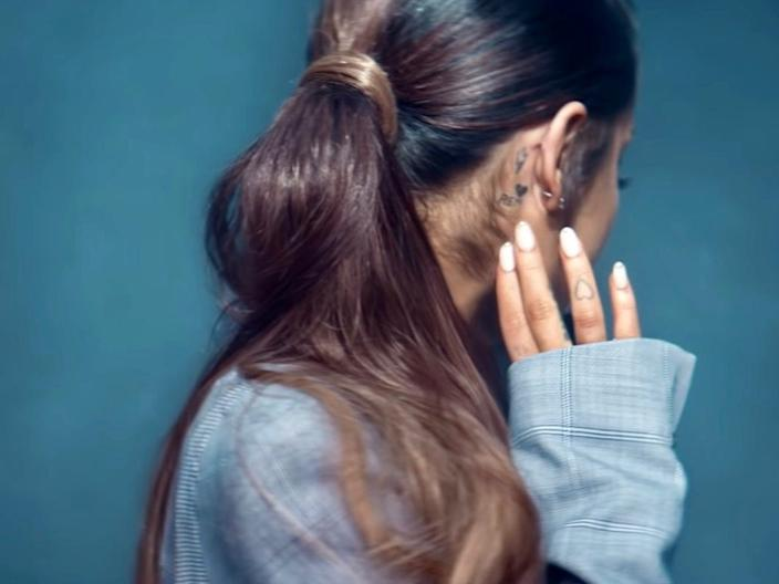 "A still from Grande's music video for ""Breathin."""
