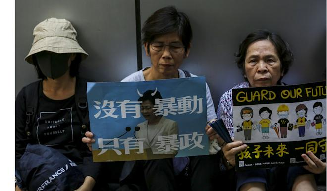 Elderly protesters outside police headquarters in Wan Chai on Saturday. The group's protest in July drew an estimated 9,000 people. Photo: Jonathan Wong