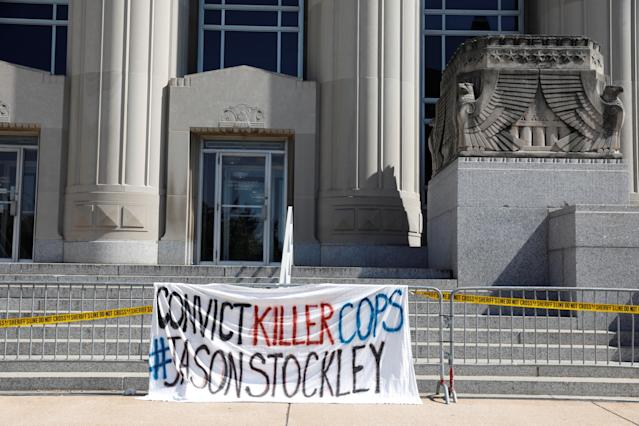<p>A sign hangs from barricades outside the courthouse during a police standoff with protesters after the not guilty verdict of Jason Stockley, a former St. Louis police officer charged with the 2011 shooting of Anthony Lamar Smith, outside the courthouse in St.Louis, Mo., Sept. 15, 2017. (Photo: Whitney Curtis/Reuters) </p>