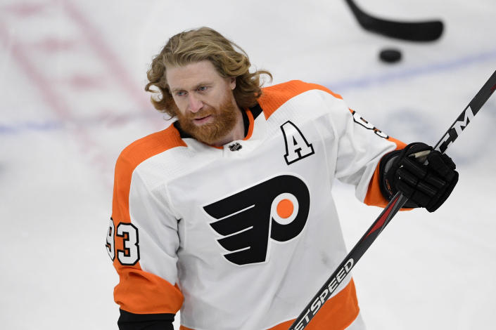 FILE - In this May 8, 2021 file photo, Philadelphia Flyers right wing Jakub Voracek (93) warms up before an NHL hockey game against the Washington Capitals in Washington. The Flyers traded Voracek to the Columbus Blue Jackets for Cam Atkinson, Saturday, July 24, in the first major trade on the second day of the NHL draft. (AP Photo/Nick Wass, File)