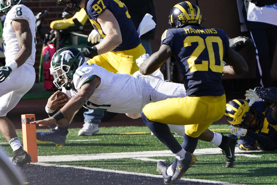 Michigan State running back Connor Heyward (11) crosses the goal line for a touchdown during the second half of an NCAA college football game against Michigan, Saturday, Oct. 31, 2020, in Ann Arbor, Mich. (AP Photo/Carlos Osorio)