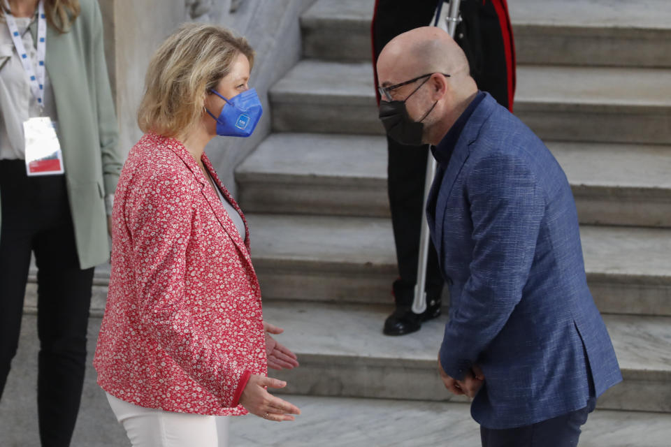 Italian Minister for Ecological Transition Roberto Cingolani, right, welcomes welcomes his French homologue Barbara Pompili as she arrives at Palazzo Reale in Naples, Italy, Thursday, July 22, 2021, to take part in a G20 meeting on environment, climate and energy. (AP Photo/Salvatore Laporta)