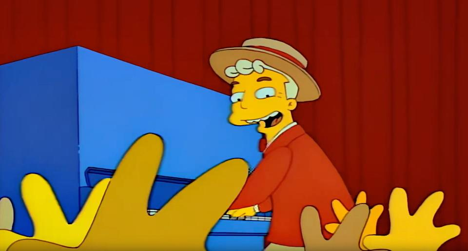 Lyle Lanley leads the residents of Springfield in The Monorail Song (Photo: Fox)