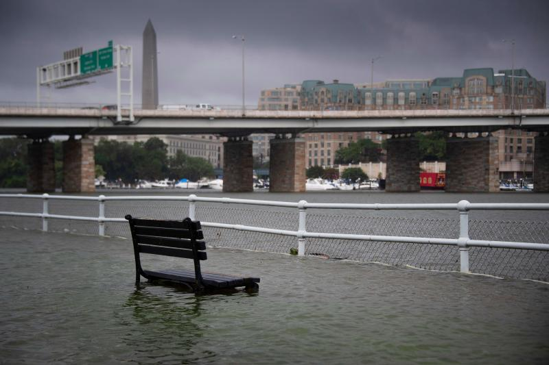 A park bench sits under water in East Potomac Park in Washington, DC on July 8, 2019, after a storm caused flooding. (Photo: Jim Watson/AFP/Getty Images)