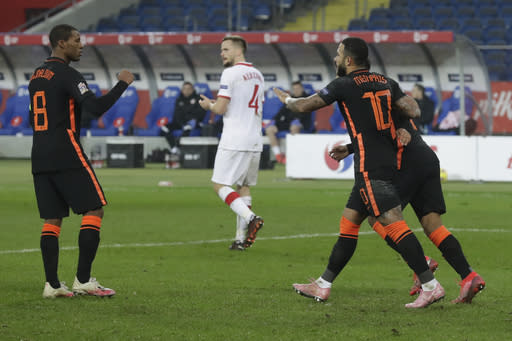 Netherlands' Georginio Wijnaldum, left, celebrates with Netherlands' Memphis Depay, right, who scored his side's first goal with a penalty during the Nations League soccer match between Poland and The Netherlands at Silesian Stadium in Chorzow, Poland, Wednesday, Nov. 18, 2020. (AP Photo/Czarek Sokolowski)