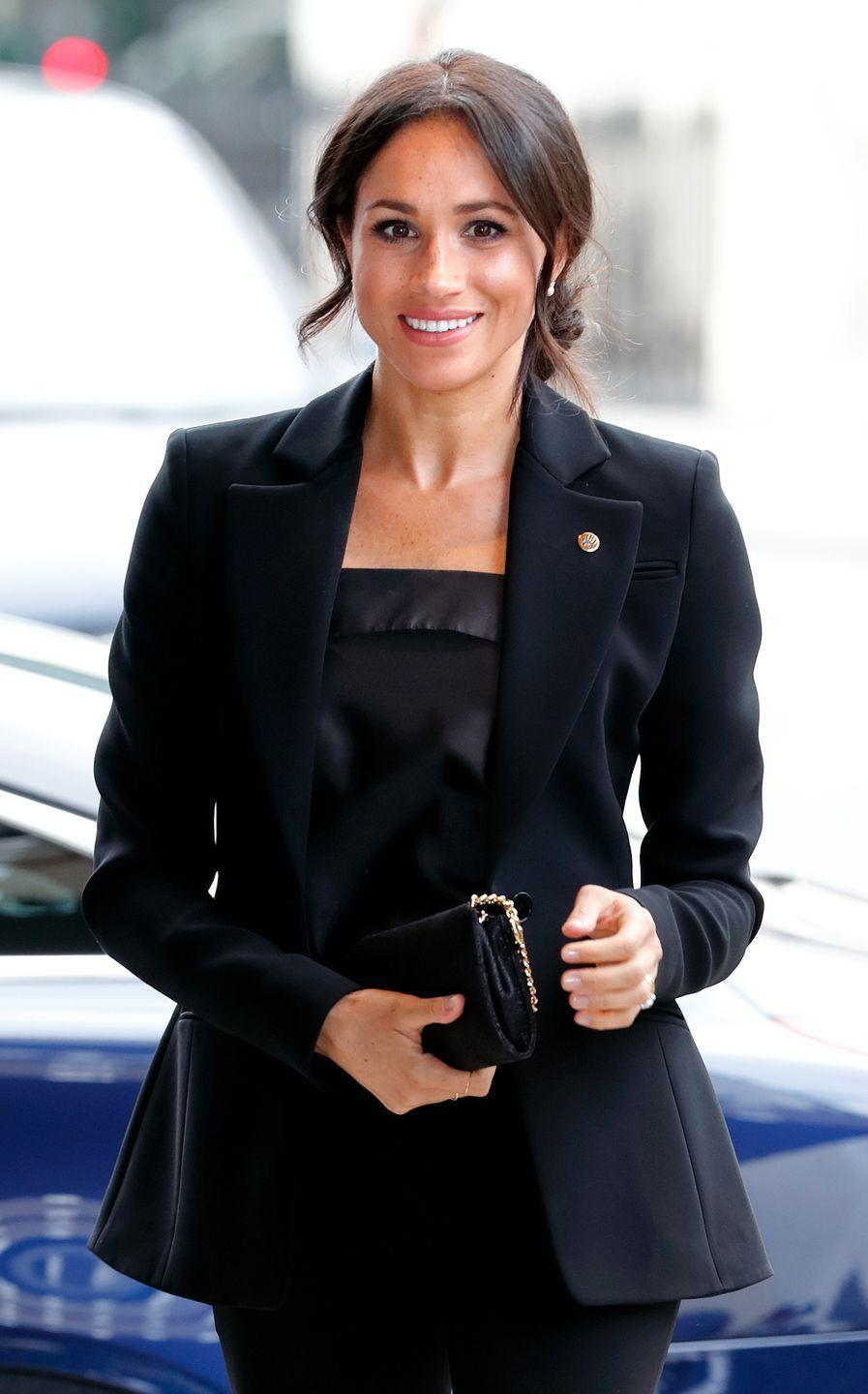 <p>In September 2018, Markle donned a black blazer over a black dress, adding structure to her outfit. </p>