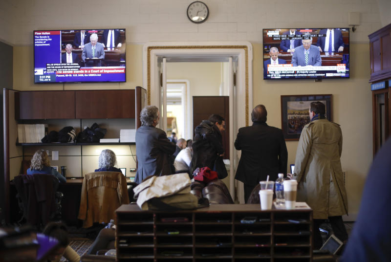 Members of the media in the press gallery watch a television monitors of Senate Majority Leader Mitch McConnell of Ky., speaking to members of the Senate for the impeachment trial against President Donald Trump at the U.S. Capitol in Washington, Thursday, Jan. 16, 2020. (AP Photo/Pablo Martinez Monsivais)