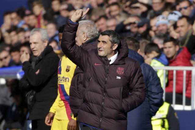 Barcelona's head coach Ernesto Valverde gives instructions from the side line during a Spanish La Liga soccer match between Leganes and FC Barcelona at the Butarque stadium in Madrid, Spain, Saturday Nov. 23, 2019. (AP Photo/Paul White)
