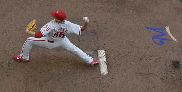Philadelphia Phillies starting pitcher David Buchanan throws during the first inning of a baseball game against the Milwaukee Brewers Thursday, July 10, 2014, in Milwaukee. (AP Photo/Morry Gash)