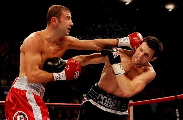 NOTTINGHAM, ENGLAND - MAY 26: Carl Froch (R) in action with Lucian Bute during their IBF World Super Middleweight Title bout at Nottingham Capital FM Arena on May 26, 2012 in Nottingham, England. (Photo by Scott Heavey/Getty Images)