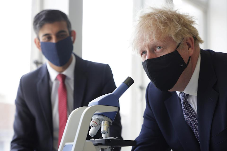 Prime Minister Boris Johnson (right) and Chancellor of the Exchequer Rishi Sunak take part in a science lesson during a visit to King Solomon Academy in Marylebone, central London. Picture date: Thursday April 29, 2021.