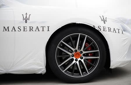 The Maserati logo is pictured on a covered vehicle at the Maserati car plant in Grugliasco, near Turin in this May 22, 2014 file photo. REUTERS/Giorgio Perottino/Files
