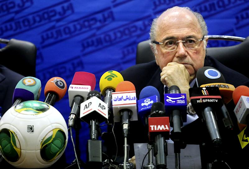 FIFA president Joseph Sepp Blatter listens during a press conference in Tehran, Iran, Thursday, Nov. 7, 2013. Blatter is saying he has urged Iranian authorities to open the gate on female football fans in Iranian stadiums. The Thursday remarks by Blatter came during a briefing in Tehran in which he said he sought Iranian decision makers including parliament speaker Ali Larijani to facilitate presence of female spectators in Iranian stadiums. The controversial issue was in the air in the conservative country over the past decades. (AP Photo/Ebrahim Noroozi)