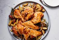 "Rendering fat trickles from the chicken as it roasts onto a bed of sliced potatoes and onions, resulting in a deliciously crisp and juicy low-fuss bird with a built-in side dish. <a href=""https://www.epicurious.com/recipes/food/views/low-fuss-crispy-roast-chicken?mbid=synd_yahoo_rss"" rel=""nofollow noopener"" target=""_blank"" data-ylk=""slk:See recipe."" class=""link rapid-noclick-resp"">See recipe.</a>"