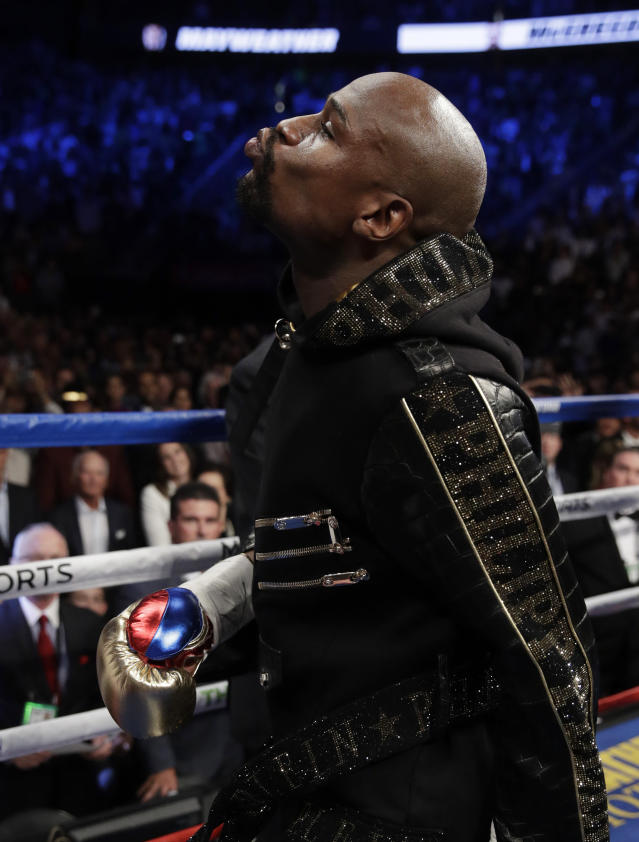 <p>Floyd Mayweather Jr. enters the ring before a super welterweight boxing match against Conor McGregor, Saturday, Aug. 26, 2017, in Las Vegas. (AP Photo/Isaac Brekken) </p>