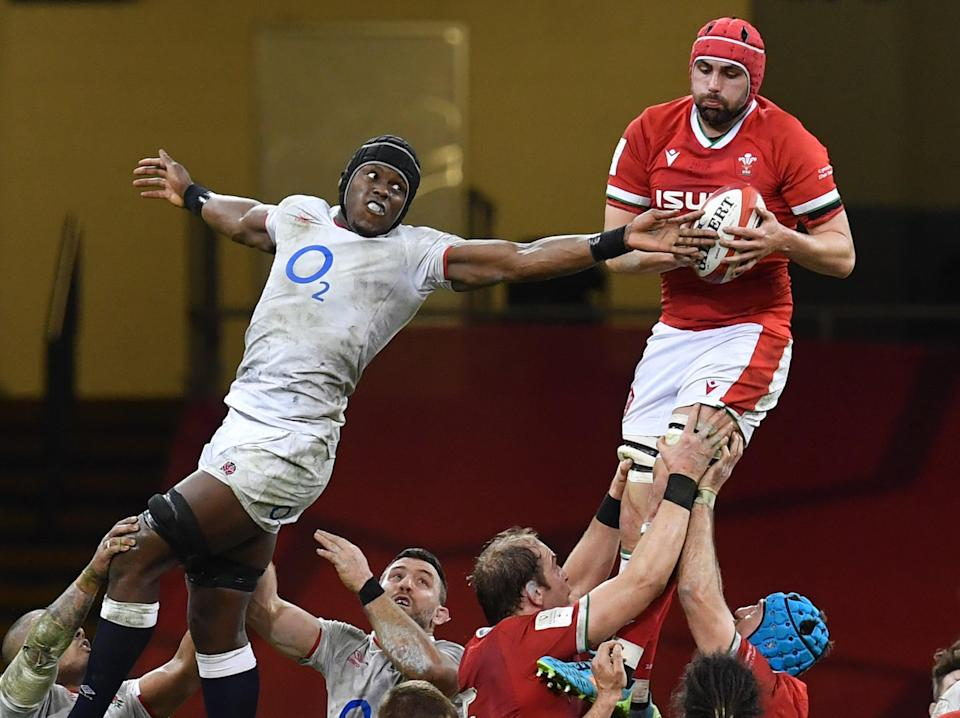 Wales' Cory Hill wins the ball from England lock Maro Itoje in the line-out (AFP via Getty Images)