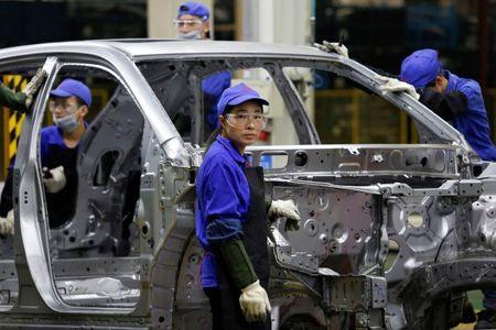 A worker looks at a BYD assembly line in Shenzhen