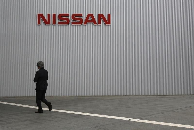 A visitor walks toward to the entrance of Nissan Motor Co's global headquarters in Yokohama