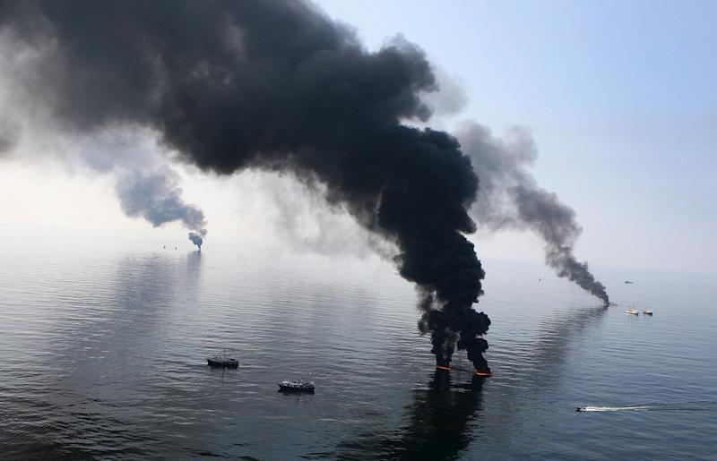 Smoke billows from a controlled burn of spilled oil off the Louisiana coast after the April 2010 Deepwater Horizon explosion killed 11 workers and ruptured BP's deep-sea well.  (Photo: Sean Gardner / Reuters)