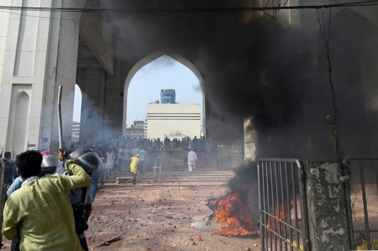 Activists from Islamist groups set a motorcycle on fire during a clash with police