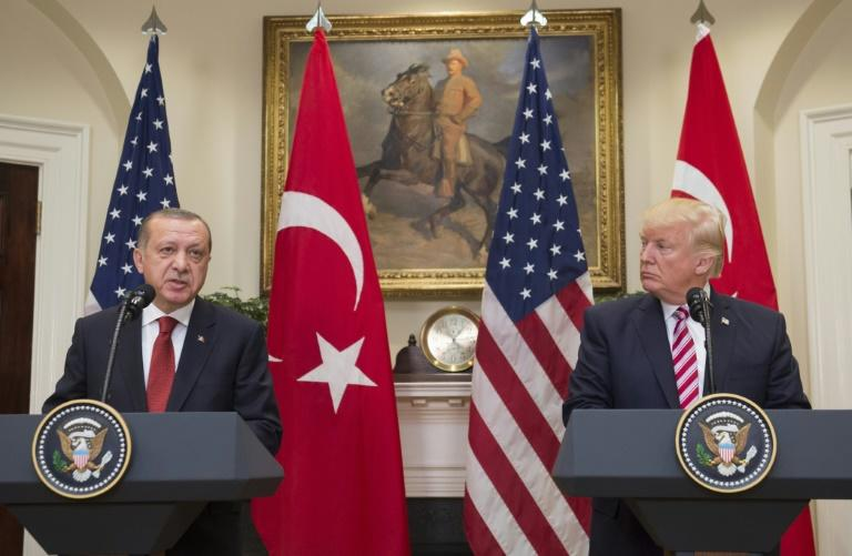 Turkish President Recep Tayyip Erdogan (L) said he had told his US counterpart Donald Trump, both seen here in 2017, to not listen to the media