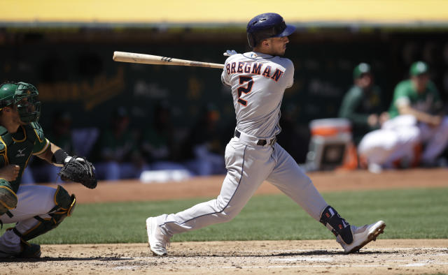 Houston Astros' Alex Bregman swings for an RBI-double off Oakland Athletics' Chris Bassitt in the third inning of a baseball game Saturday, Aug. 17, 2019, in Oakland, Calif. (AP Photo/Ben Margot)