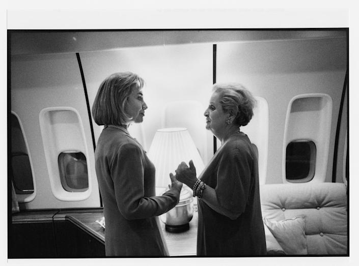 Speaking with Secretary of State Madeleine Albright aboard Air Force One en route to Europe. May 26, 1997.